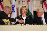 Benjamin Netanyahu Photo - United States Secretary of State Hillary Rodham Clinton center smiles as Prime Minister Benjamin Netanyahu of Israel left and Mahmoud Abbas of the Paqlestinian Authority shake hands following their remarks at the start of the Relaunch of Direct Negotiations Between the Israelis and Palestinians in the Benjamin Franklin Room of the US Department of State on Thursday September 2 2010  Credit Ron Sachs  CNP(RESTRICTION NO New York or New Jersey Newspapers or newspapers within a 75 mile radius of New York City)