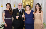 Terry George Photo - (L-R) Actress Maya Rudolph filmmakers Oorlagh George and Terry George and actress Kristen Wiig pose in the press room at the 84th Annual Academy Awards held at the Hollywood  Highland Center on February 26 2012 in Hollywood California