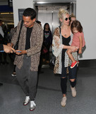 Ashley Simpson Photo - Photo by SMXRFstarmaxinccomSTAR MAX2017ALL RIGHTS RESERVEDTelephoneFax (212) 995-11967717Evan Ross Ashley Simpson and their daughter Jagger Snow Ross are seen at LAX Airport in Los Angeles CA