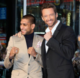 Amir Khan Photo - Hugh Jackman and Amir Khan at the UK premiere of Real Steel held at Leicester Square London UK 14th September 2011
