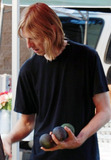 Avocado Photo - Eric Erlandson co-founder and former lead guitarist for the rock band Hole picks up some fresh food including avocados while shopping at a farmers market in Hollywood  Los Angeles CA 082210