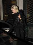 Alicia Douvall Photo - Model Alicia Douvall leaves The Ivy Club with her head down covering her face with her hand Douvall reportedly previously admitted to being a plastic surgery addict but said she wasnt going to have any more procedures But later reports said she flew to the US for procedures after UK doctors refused treatment London UK 111910