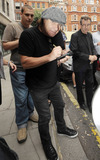 ACDC Photo - EXCLUSIVE Lead singer for the legendary rock band ACDC Brian Johnson signs autographs for waiting fans outside BBC Radio studio  Johnson peered out from under his grey drivers cap and smiled for the camera  When asked if hed pose beside BBC Radio 2 DJ Chris Evans new Ferrari he reportedly said jokingly With all due respect why would I want to pose in front of someone elses car I just bought a new Ferrari today London UK 072910Fees must be agreed prior to publication