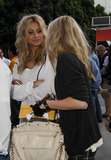 ALY AJ Photo - Alyson Michalka and Amanda Michalka (also known as Aly  AJ) of the pop band 78violet arrive at the Staples Center to watch the Utah Jazz verses the Los Angeles Lakers basketball game Los Angeles CA 040511