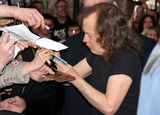 ACDC Photo - ACDC band member Angus Young at the ACDC Live at River Plate DVD World Premiere at the HMV Hammersmith Apollo London UK 5611