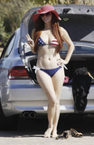 American Flag Photo - Phoebe Price celebrates Labor Day Weekend at the Malibu Chili Cook-Off Festival Phoebe models a patriotic American flag bikini in the parking lot and later seen wearing a black cover up over her bikini Malibu CA 3rd September 2011