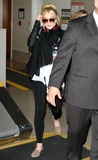 Charles Manson Photo - Lindsay Lohan looks a bit tired tired as she arrives at LAX after a flight from New York With her ponytail looking a bit-dissheveled Lohan was aided by bodyguards as she made her way through the terminal wearing headphones around her neck Despite her recent legal problems Lindsay is reportedly up for two very different film roles She will reportedly be auditioning for the part of a villain in the new Superman movie And reports say she is up for the role of Sharon Tate in an upcoming film about Charles Manson Los Angeles CA 4711