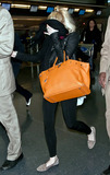 Charles Manson Photo - Lindsay Lohan looks to be in good spirits as she heads for a flight at New Yorks JFK International Airport Lohan who carried an orange handbag and wore a black jacket and black scarf over a white top paired with black leggings and animal print shoes covered her face as she walked through the terminal accompanied by bodyguards Despite her recent legal problems Lindsay is reportedly up for two very different film roles She will reportedly be auditioning for the part of a villain in the new Superman movie And reports say she is up for the role of Sharon Tate in an upcoming film about Charles Manson New York NY 4611