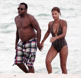 Alicia Etheridge Photo - Singer Bobby Brown takes a dip in the warm Miami Beach ocean with his fiancee Alicia Etheridge Miami FL 092610