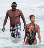 Alicia Etheridge Photo - Singer Bobby Brown takes a dip in the warm Miami Beach ocean with his fiancee Alicia Etheridge Miami FL 092610