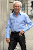 Tony Christie Photo - Singer Tony Christie is all smiles as he poses for photos while arriving at BBC Radio 2 for an appearance London UK 7710