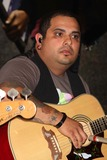 Taking Back Sunday Photo - Eddie Reyes of Taking Back Sunday Performing From Their New Album New Again to Celebrate to Launch of New Clothing Brand Dcoded at Macys Herald Square in New York City on 08-16-2009 Photo by Henry Mcgee-Globe Photos Inc 2009