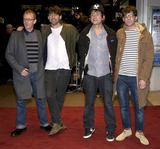 Alex James Photo - Dave Rowntree Alex James Damon Albarn and Graham Coxonof the band Blur attends World Premiere of No Distance To Run - a documentary about the band Blur at Odeon West End on January 14 2010 in London England