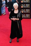 Judi Dench Photo - Judi Dench arrives for the Laurence Olivier Awards 2014 at the Royal Opera House Covent Garden London 13042014 Picture by Henry Harris  Featureflash