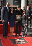 Earvin Magic Johnson Photo - Recording staractor LL Cool J with wife Simone Smith  Earvin Magic Johnson  wife Cookie Johnson on Hollywood Boulevard where LL Cool J was honored with the 2571st star on the Hollywood Walk of FameJanuary 21 2016  Los Angeles CAPicture Paul Smith  Featureflash