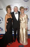 Aaron Spelling Photo - Actress TORI SPELLING with parents producer AARON SPELLING  wife CANDY at the 15th Carousel of Hope Ball at the Beverly Hilton Hotel Beverly Hills15OCT2002   Paul Smith  Featureflash
