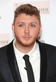 Amy Winehouse Photo - James Arthur arriving at the The Amy Winehouse foundation ball held at the Dorchester hotel London 20112012 Picture by Henry Harris  Featureflash
