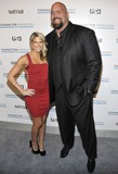 The Big Show Photo - Professional wrestlers Kelly Kelly and The Big Show (R) attend the USA Network and Vanity Fair Character Approved honorees reception in New York NY on February 25th 2010 (Pictured Kelly Kelly The Big Show)