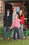 Anna Popplewell Photo - London The children from The Chronicles of Narnia (Skandar Keynes -blue jumper Georgie Henley - pink jacket William Moseley - striped shirt and Anna Popplewell - red jacket) attends the launch of the 10th Anniversary of National Schools Film Week at the Odeon Leicester Square12 October 2005Ali KadinskyLandmark Media