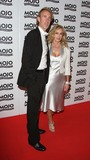 Mike Rutherford Photo - London UK  Mike Rutherford  (Genesis) with wife Angie     at the  Mojo Honours List Awards held at Old Truman Brewery  London  16th June  2008 Keith MayhewLandmark Media