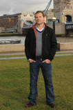 George Cole Photo - London UK Lex Shrapnel poses to launch Fives remake of the popular 80s sitcom starring Dennis Waterman and George Cole at Tower Bridge13 JanuaryAli KadinskyLandmark Media