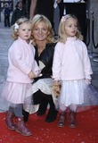 Alice Beer Photo - London UK Alice Beer and her daughters arrive at the 9th annual gala performance of the famous Raymond Briggs story The Snowman at Sadlers Wells Peacock Theatre in London 9th December 2006 Ali KadinskyLandmark Media