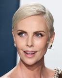 Jimmy Choo Photo - (FILE) Charlize Theron Announces 1 Million Dollar Donation Amid Coronavirus COVID-19 Pandemic Charlize Theron has donated 1 million dollars to the coronavirus relief efforts through her foundation The Charlize Theron Africa Outreach Project and partners CARE and the Entertainment Industry Foundation (EIF) BEVERLY HILLS LOS ANGELES CALIFORNIA USA - FEBRUARY 09 Actress Charlize Theron wearing Dior Haute Couture with Jimmy Choo shoes and clutch arrives at the 2020 Vanity Fair Oscar Party held at the Wallis Annenberg Center for the Performing Arts on February 9 2020 in Beverly Hills Los Angeles California United States (Photo by Xavier CollinImage Press Agency)