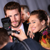 Cake Photo - (FILE) Miley Cyrus and Liam Hemsworth Appear to Be Married Miley Cyrus and Liam Hemsworth appeared to have tied the knot six years after getting engaged Miley Cyrus and Liam Hemsworth are believed to have tied the knot in a low-key ceremony at home The singer 26 and actor 28 who got engaged six years ago have been seen cutting their wedding cake in a series of photos on social media HOLLYWOOD LOS ANGELES CA USA - OCTOBER 10 Actor Liam Hemsworth and girlfriendsinger Miley Cyrus arrive at the World Premiere Of Disney And Marvels Thor Ragnarok held at the El Capitan Theatre on October 10 2017 in Hollywood Los Angeles California United States (Photo by Xavier CollinImage Press Agency)