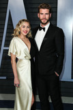 TI Photo - (FILE) Miley Cyrus and Liam Hemsworth Appear to Be Married Miley Cyrus and Liam Hemsworth appeared to have tied the knot six years after getting engaged Miley Cyrus and Liam Hemsworth are believed to have tied the knot in a low-key ceremony at home The singer 26 and actor 28 who got engaged six years ago have been seen cutting their wedding cake in a series of photos on social media BEVERLY HILLS LOS ANGELES CA USA - MARCH 04 Singer Miley Cyrus and boyfriendactor Liam Hemsworth arrive at the 2018 Vanity Fair Oscar Party held at the Wallis Annenberg Center for the Performing Arts on March 4 2018 in Beverly Hills Los Angeles California United States (Photo by Xavier CollinImage Press Agency)