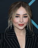 Sabrina Carpenter Photo - SANTA MONICA LOS ANGELES CA USA - NOVEMBER 11 Singer Sabrina Carpenter wearing a Tom Ford suit Brian Atwood shoes and H Stern jewelry (styled by Jason Bolden) arrives at the Peoples Choice Awards 2018 held at Barker Hangar on November 11 2018 in Santa Monica Los Angeles California United States (Photo by Xavier CollinImage Press Agency)