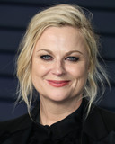 Amy Poehler Photo - BEVERLY HILLS LOS ANGELES CA USA - FEBRUARY 24 Actress Amy Poehler wearing a custom Alberta Ferretti tux Steve Madden shoes Lorraine Schwartz jewelry and Tyler Ellis bag arrives at the 2019 Vanity Fair Oscar Party held at the Wallis Annenberg Center for the Performing Arts on February 24 2019 in Beverly Hills Los Angeles California United States (Photo by Xavier CollinImage Press Agency)