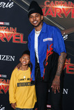 Nick Young Photo - HOLLYWOOD LOS ANGELES CA USA - MARCH 04 Nick Young Jr and father Nick Young arrive at the World Premiere Of Marvel Studios Captain Marvel held at the El Capitan Theatre on March 4 2019 in Hollywood Los Angeles California United States (Photo by Xavier CollinImage Press Agency)