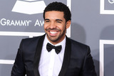 Grammy Awards Photo - (FILE) Drake Makes Historic Debut at No 1 on Billboard Hot 100 With Toosie Slide He becomes the first male act with three No 1 arrivals as he scores his seventh total topper LOS ANGELES CA USA - FEBRUARY 10 Rapper Drake wearing Saint Laurent arrives at the 55th Annual GRAMMY Awards held at Staples Center on February 10 2013 in Los Angeles California United States (Photo by Xavier CollinImage Press Agency)