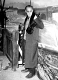Alec Guinness Photo - Alec Guinness Making the Film the Lady Killers Supplied by Globe Photos Inc