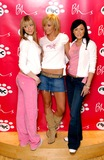 Atomic Kitten Photo - 18022003LIZ McLARNON JENNY FROST AND NATASHA HAMILTON    ATOMIC KITTENAC CHILDRENS CLOTHING LAUNCH-BHS LONDON-who launched a childrens clothing range called AK which will be sold by British Home StoresPHOTO BYPAUL HENNESSYGlobelinkUKGLOBE PHOTOS INC  2003K29177 NORTH AND SOUTH AMERICA ONLY
