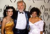Kenny Rogers Photo - Latoya Jackson Kenny Rogers and Janet Jackson 1985 American Music Awards I3535 Photo by Phil RoachipolGlobe Photos Inc