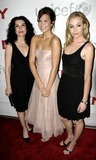 Julianne Margulies Photo - 08 November 2005 - New York NY - Margulies Moore and De Rossi attend Donna Karan launch party for DKNY Be Delicious (Message Of Hope) limited edition fragrance to benefit UNICEF at DKYN Madision Avenue Store (L to R Julianne Margulles  Mandy Moore and Portia De Rossi wearing Donna Karan dresses  Digital Image   Photo Credit  Anthony G MooreGLOBE PHOTOSK45912AGM