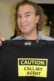 Brad Elterman Photo - Occhi Eye Boutique Grand Opening Hosted by Lorenzo Randisi Occhi West Hollywood CA 08-30-2005 Photo Clinton Hwallace-ipol-Globe Photos Inc Brad Elterman with a T-shirt From His Clothing Line Called Papparazzi Chic