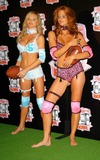 Traci Bingham Photo - - Angie Everhart Nikki Ziering and Traci Bingham Unveils Plans For Lingerie Bowl 2004 - Quixote Studios West Hollywood CA - 06252003 - Photo by Jonathan Friolo  Globe Photos Inc 2003 - Nikki Ziering and Angie Everhart
