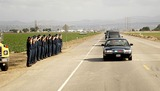 President Ronald Reagan Photo - FIREFIGHTERS SALUTE THE HEARSE -The flag draped casket of former president Ronald Reagan is carried in the hearse for transport to the Naval Base Ventura County at Point Mugu from the Ronald Reagan Presidential Library and then flown to Washington DC for the state funeralMOORPARK CA -06092004 -PHOTO BY POOLGLOBE PHOTOS INC2004K37630NP