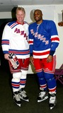 Amani Toomer Photo - Superskate Vi a Celebrity Hockey Event to Benefit Rangers Cheering For Children and Crpf at Madison Square Garden in New York City 1252004 Photo Bybarry TalesnickipolGlobe Photos Inc 2004 Boomer Esiason and Amani Toomer