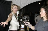 Ashley Paige Photo - I9251CHWBACKSTAGE AT THE ASHLEY PAIGE SPRINGSUMMER COLLECTION SHOW -MERCEDES BENZ SPRING 2005 FASHION WEEK SMASHBOX STUDIOS CULVER CITY CA10272004PHOTO BY CLINTON H WALLACEIPOLGLOBE PHOTOS INC 2004SAMAIRE ARMSTRONG GETTING A SPRAY TAN FROM CALIFORNIA TAN