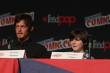 Chandler Riggs Photo - Norman Reeduschandler Riggs Talking About New Season Ofwalking Dead at NY Comic Con at Javit Center 10-13-2012 Photo by John BarrettGlobe Photos