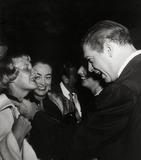 Barbara Stanwyck Photo - Joan Crawford Watches As Milton Berle Ties a Ribbon Around Christina Crawfords Neck Bg Barbara Stanwyck Photo Nate CutlerGlobe Photos Inc